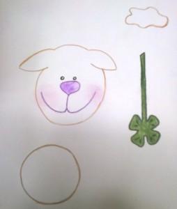 nakreslená hlava ovečky a čtyřlístek