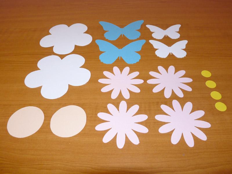 květina a motýl vysřižení z barevného papíru