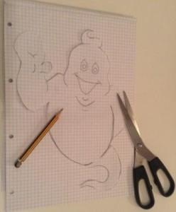 Duch nakreslený tužkou na papíře a připravený k vystřižení