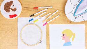 Popisovače Edding, kruh na vyšívání a látka na vytvoření nástěnného obrázku