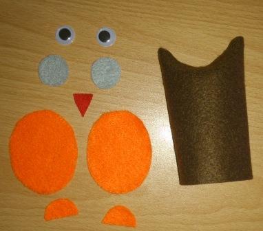 nstříhané části sovičky z filcového papíru